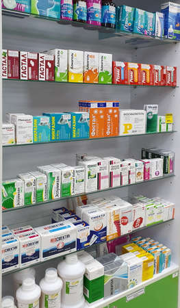 Nadym, RUSSIA-NOVEMBER 07, 2020: Shelf in a pharmacy with products for the treatment of diseases of the gastrointestinal tract