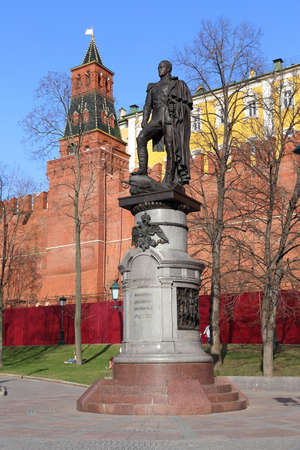 Moscow, RUSSIA - APRIL 30, 2017: Monument to Emperor Alexander the First against the backdrop of the Kremlin's Commandant Tower in the Alexander Garden