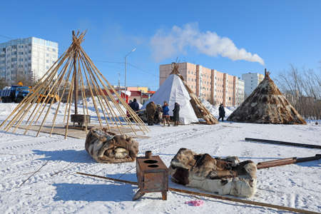 Nadym, RUSSIA-MARCH 11, 2021: Native inhabitants of northern Siberia Nenets reindeer herders establish traditional dwellings on the outskirts of the city Editorial