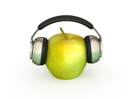 green apple in which headphones are connected photo