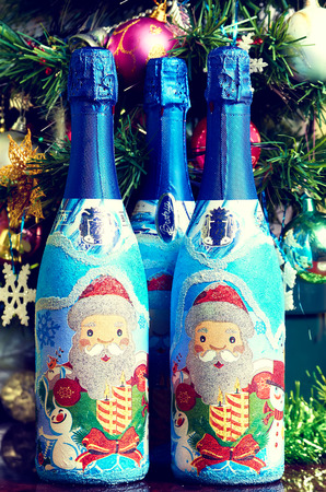 Bottle of champagne and christmas decorations.