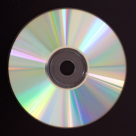 coping: DVD disc on black background