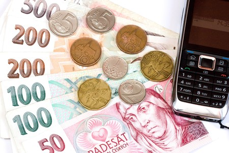 Czech bank notes, coins and mobil phone  Stock Photo