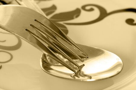 Fork and spoon on a plate Stock Photo
