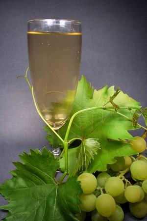 Glass white wine on black background photo