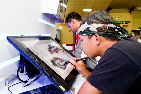 KUALA LUMPUR, MALAYSIA - DEC 3: An unidentified artist showcasing a digital sketching of a concept car during Kuala Lumpur International Motor Show (KLIMS2010) on December 8, 2010 in Kuala Lumpur Malaysia.   Stock Photo - 10290466