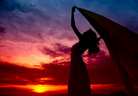 countenance: Silhouette of woman enjoy the sunset