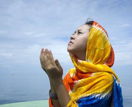 meditation pray religion: young muslim girl praying