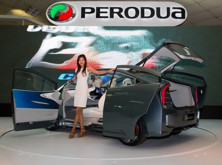 autoshow: KUALA LUMPUR - DEC 03: An Asian Model pose with Perodua Bezza, a concept car which was launched at the Kuala Lumpur International Motor Show 2010  on DECEMBER 3, 2010 in Kuala Lumpur, Malaysia