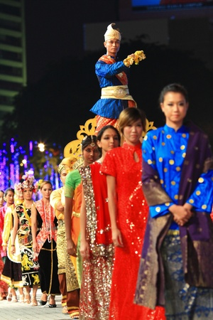 cultural and ethnic clothing: MAY 21 : Participants wearing a traditional malaysian costume during the rehearsal of Colours of Malaysia Festival May 21, 2010 in Kuala Lumpur Malaysia.