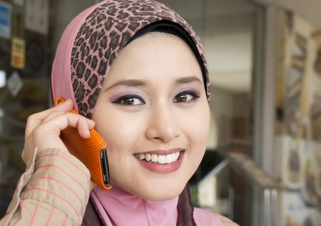 muslim young girl make a phone call  photo