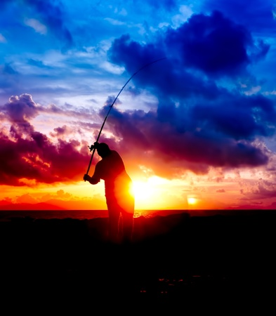 silhouette man fishing photo