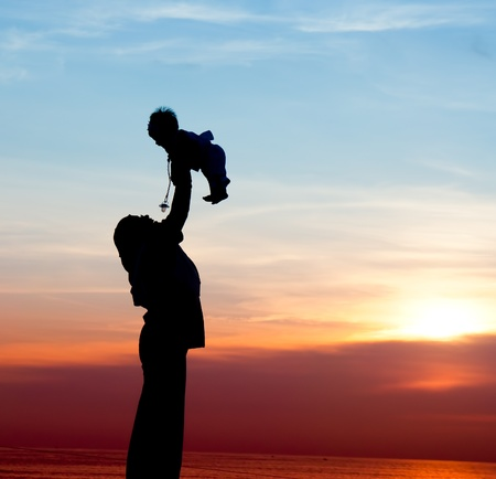 daughter mother: silhouette of mother playing with her child
