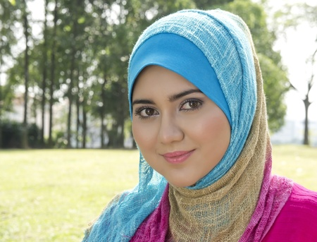mystery of faith: Lovely smile from Muslim girl  Stock Photo