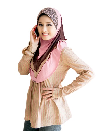 pretty young muslim woman with phone Stock Photo