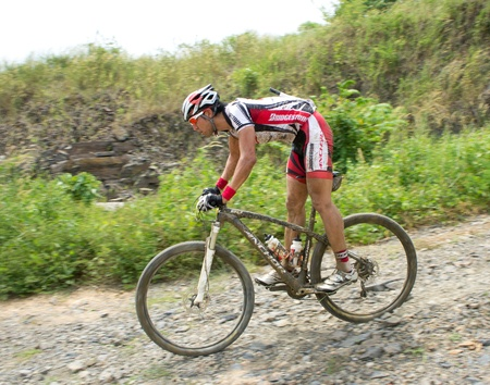 LANGKAWI - 18 October : Participant is performing action in Langkawi International Mountain Bike Challenge On 18 October 2011. 5 day stage race until 22 Oct. 2011