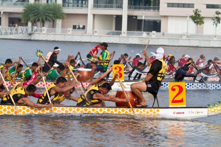 dragonboat: PUTRAJAYA, MALAYSIA - JUNE 20 : International participants row their boats during the 1Malaysia International Dragon Boat Festival 2010 (1MIDBF) JUNE 20, 2010 in Putrajaya Malaysia.  Editorial