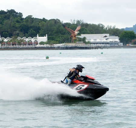 LANGKAWI, MALAYSIA - APRIL 13 : Unidentified rider pumps up his machine during Langkawi International Formula Jet Ski Super Series, April 13, 2012 in Langkawi, Malaysia. Stock Photo - 13154582