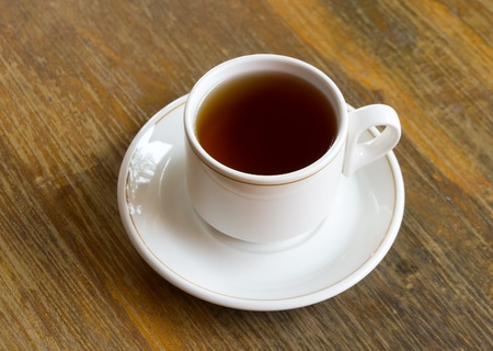 cup of tea on wooden table photo