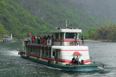 GUILIN, CHINA - APRIL 11 :  A cruise boat down the Li River in Guilin, April 11, 2011. A trip on a cruise boat down the Li River to Yangshuo is a popular activity in Guilin