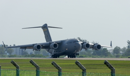 LANGKAWI, MALAYSIA - MARCH 26: US Air Force C-17 Globemaster performing at the LIMA 2013 airshow March 26, 2013 in Langkawi, Malaysia  Editorial