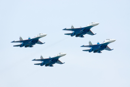 LANGKAWI, MALAYSIA - MARCH 27: SU27 from RUSSIAN KNIGHTS performing at the LIMA 2013 airshow March 26, 2013 in Langkawi, Malaysia