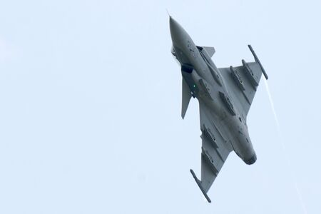 LANGKAWI, MALAYSIA - MARCH 27: GRIPEN from ROYAL THAI AIR FORCE performing at the LIMA 2013 airshow March 26, 2013 in Langkawi, Malaysia