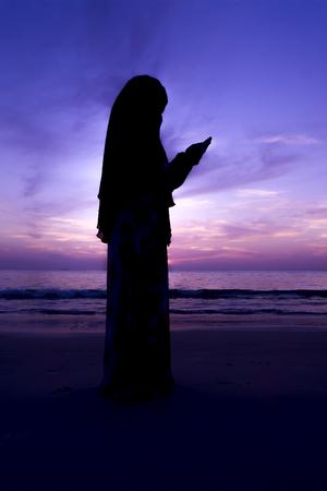 muslim woman pray at the beach