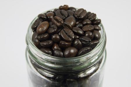 capuchino: coffee bean in glass on white screen