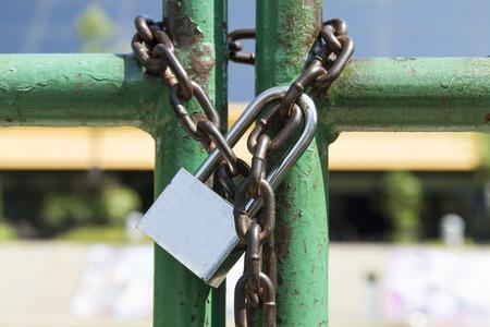 Padlock with chain on old steel door
