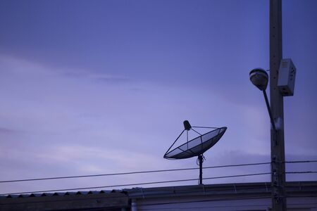 sattelite: Sattelite dish on the roof in twilight time