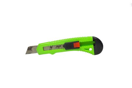box cutter: Old green box cutter with rust isolated on white background Stock Photo