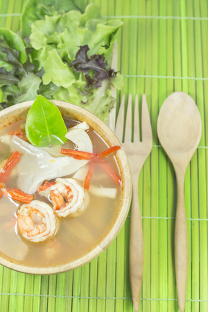 goong: Tom yum goong homemade thai style food with wooden kitchenware Stock Photo