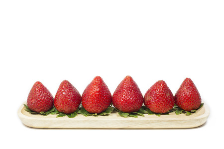 sorted: Strawberry sorted on wooden dish in white background Stock Photo