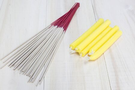 glow stick: Incense sticks and candle on wooden background
