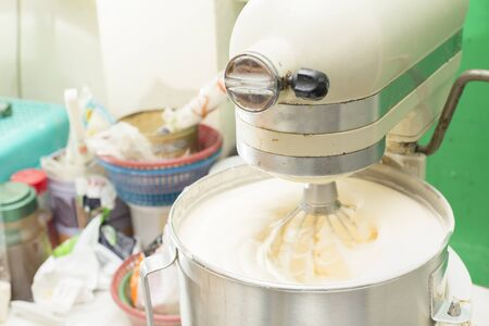 beater: Dough mixer machine kneading the dough.