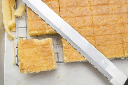 bread knife: Orange butter cake style homemade cut by bread knife.