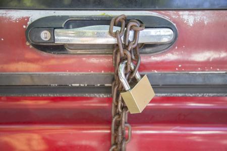 misuse: Misuse steel padlock with chain locked handle car door.