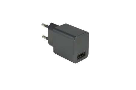convertor: AC adapter for charging the phone USB socket port on white background with clipping path