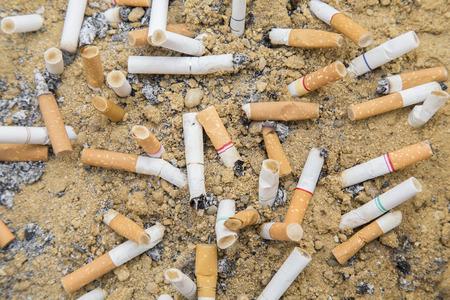 ashtray: Cigarettes butt smoked  in ashtray sand