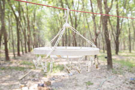 clothespins: Old and white plastic clothespins on a rope Stock Photo