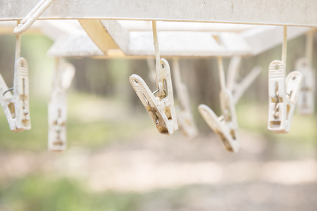 clothespins: Old and dirty white plastic clothespins