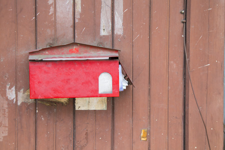 red post box: Red post box on wooden background with copyspace Stock Photo