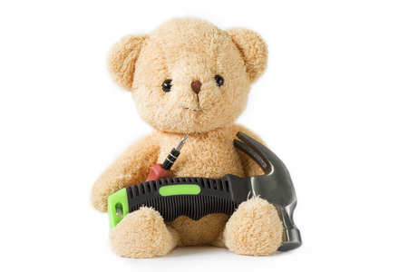 Bear doll sitting with screwdriver and hammer technician on whitebackground isolated