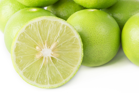 lemon wedge: Fresh slice lime isolated on white background