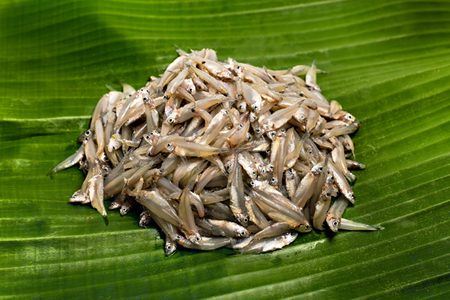 Raw anchovies fish on banana leaf It is high in calcium.