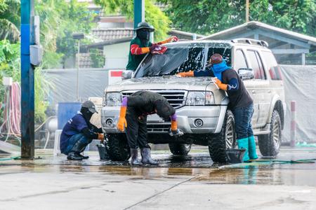 dirty car: team Worker washing car in the carwash