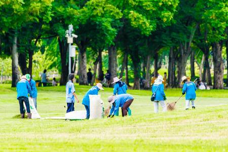 volunteering: teamWork collect garbage in the park