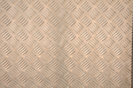 Clean metal diamond plate, seamlessly tillable as a background pattern Stock Photo - 13730397