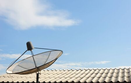 Satellite dish with sky on roof  photo